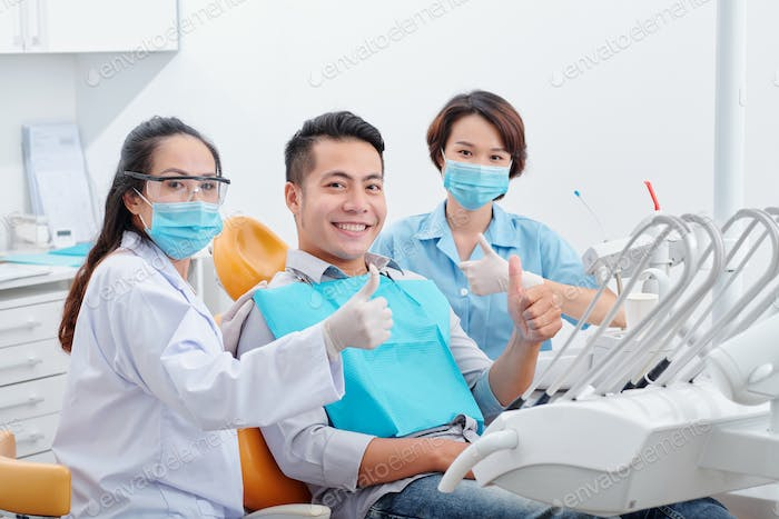 Happy patient and dentists