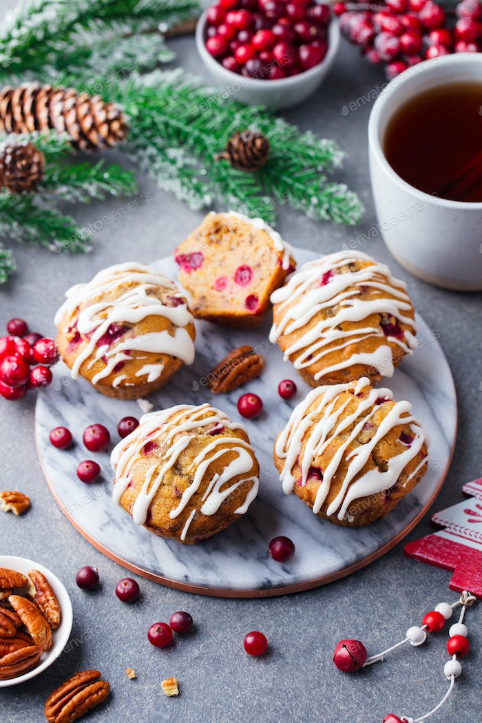 Muffins, Cakes with Cranberry and Pecan Nuts. Christmas Decoration.