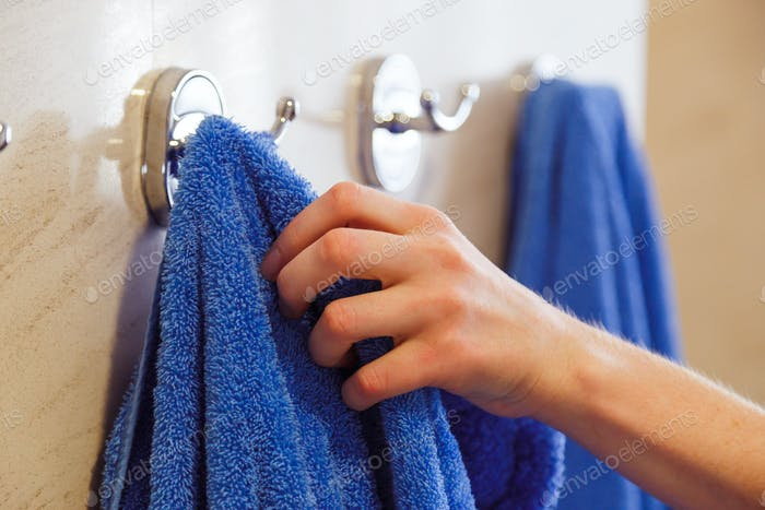 towel for hands hanging on a rack in the bathroom