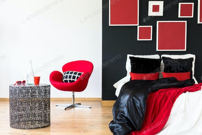 Black wall in a bedroom