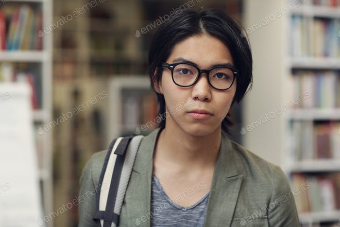 Asian student in the library