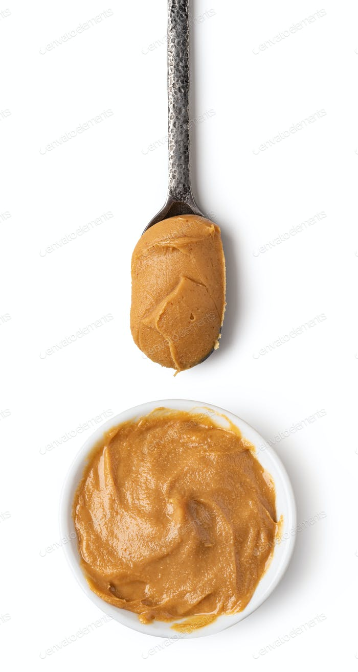 Glass bowl and spoon of peanut butter