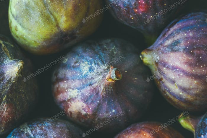 Close-up of fresh ripe seasonal purple figs, top view