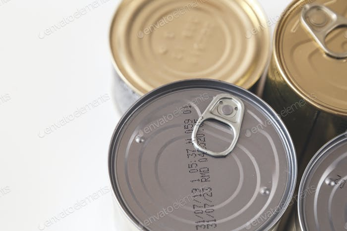 Tin, canned food isolated on white. Stock and proviant concept. Long-term storage products.