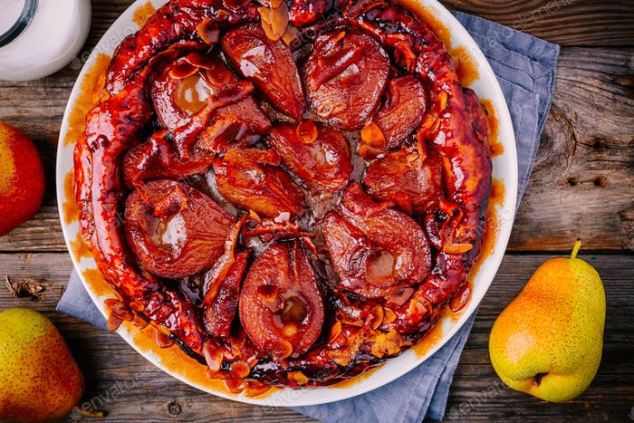 Tarte tatin with caramelized pears, orange peel and almonds