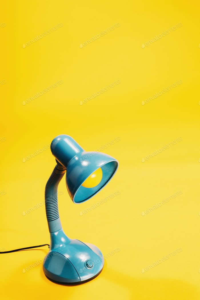 Sky-blue desk lamp on yellow background.