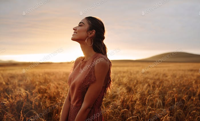 Happy woman enjoying in the nature