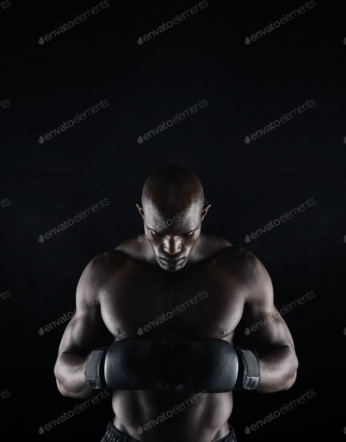 African boxer preparing for fight