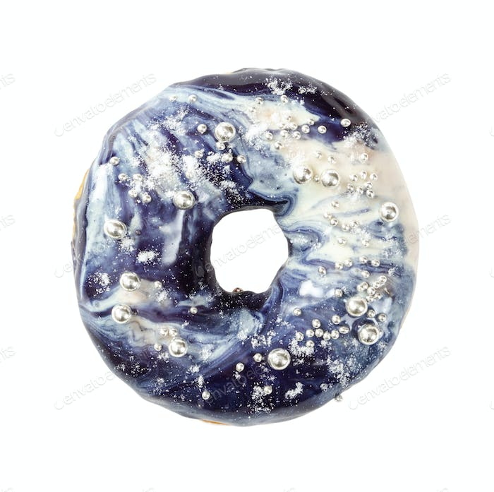 Donut with blue cosmic icing isolated on white