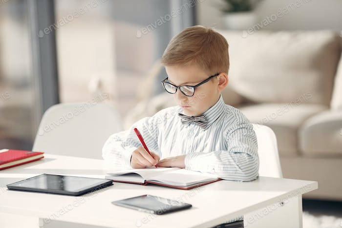 Child at the office with a laptop