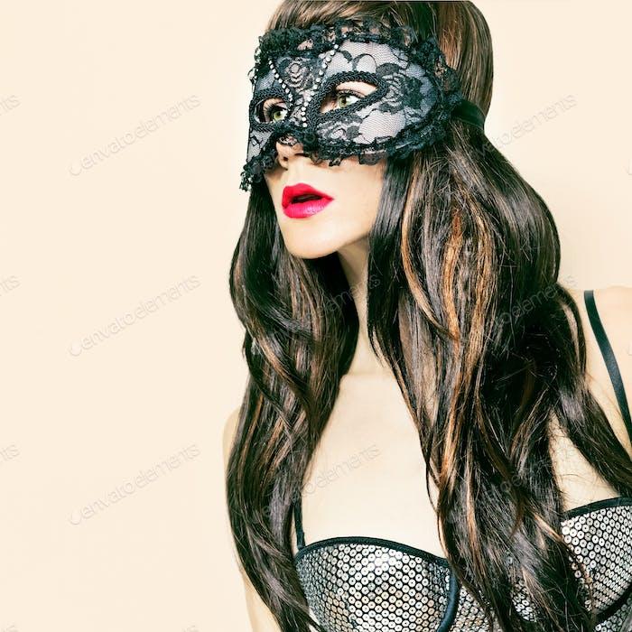 sensual brunette lady in fancy mask. carnival party