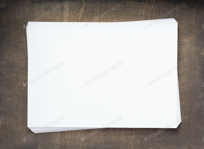 stack of paper empty pages on wood