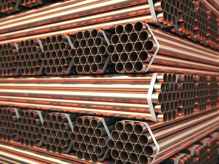 Copper or bronze metal pipes in warehouse. Heavy non-ferrous met