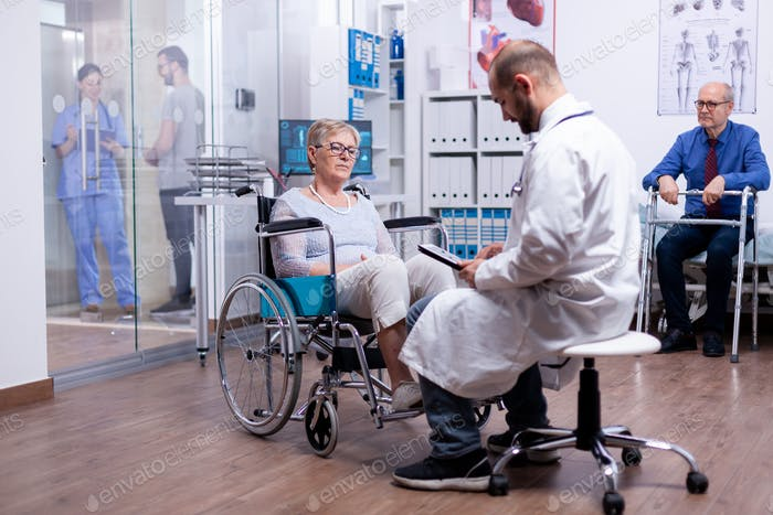 Woman with parkinson sitting in wheelchair