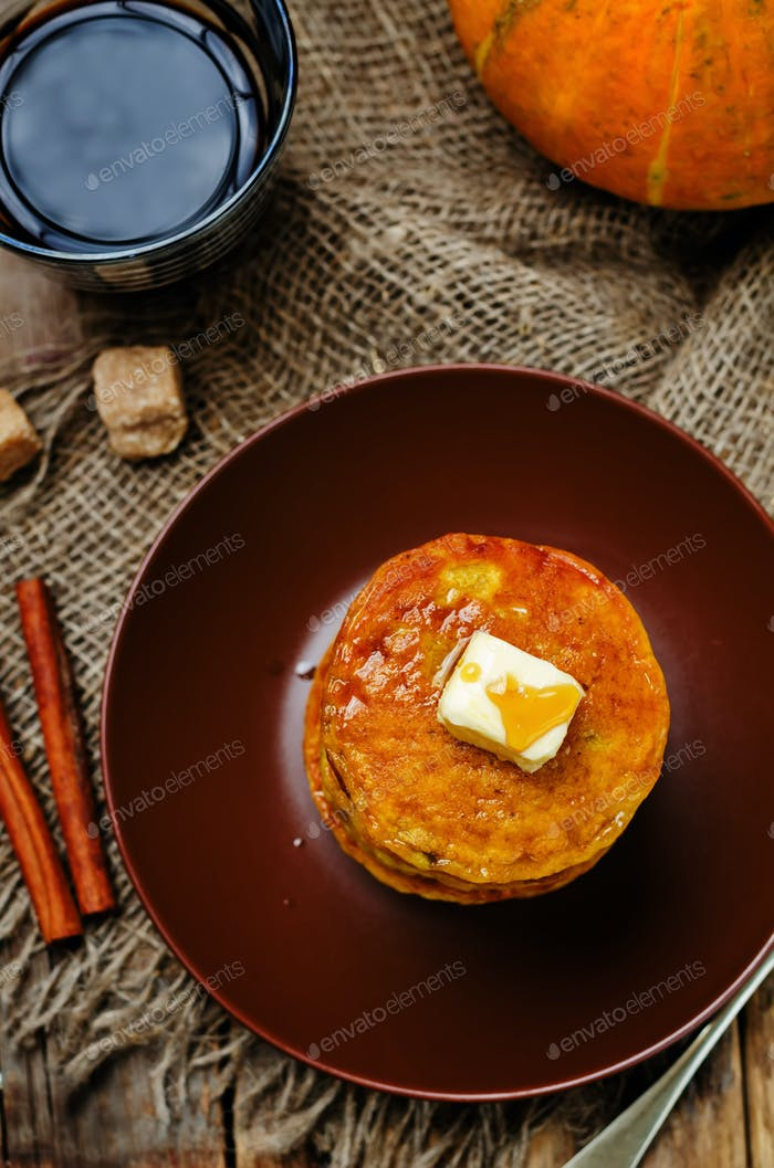Banana Pumpkin Pancake with butter and maple syrup