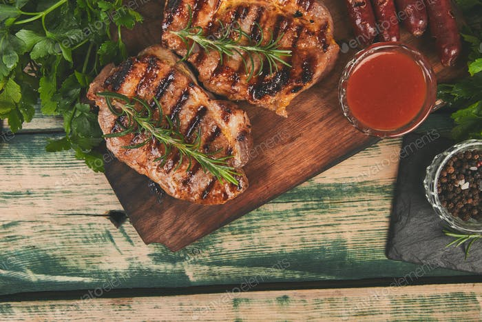 Steak pork grill on wooden cutting board