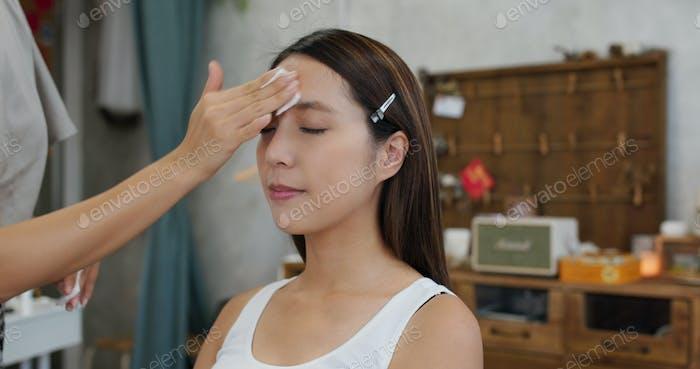 Female model having make up in the beauty salon