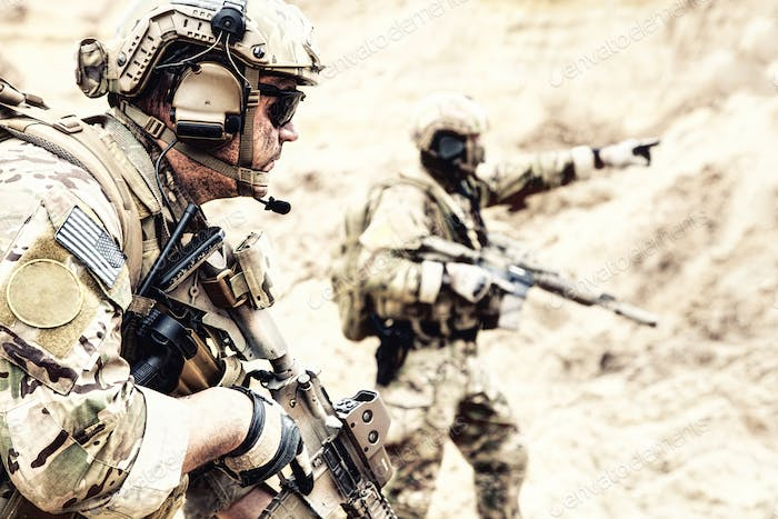 Special reconnaissance team members in desert area