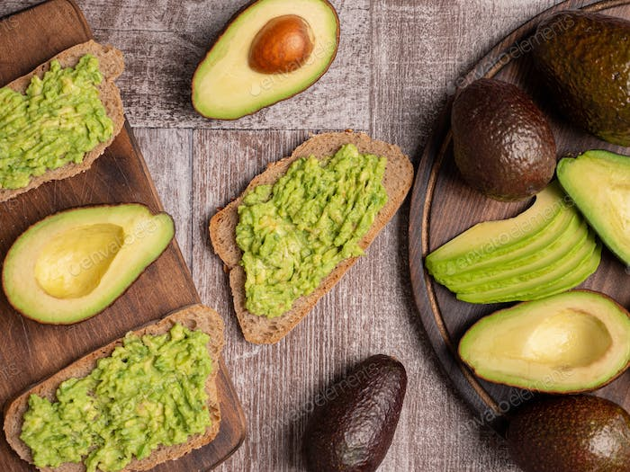 Healthy sandwiches made with avocado on a wooden board