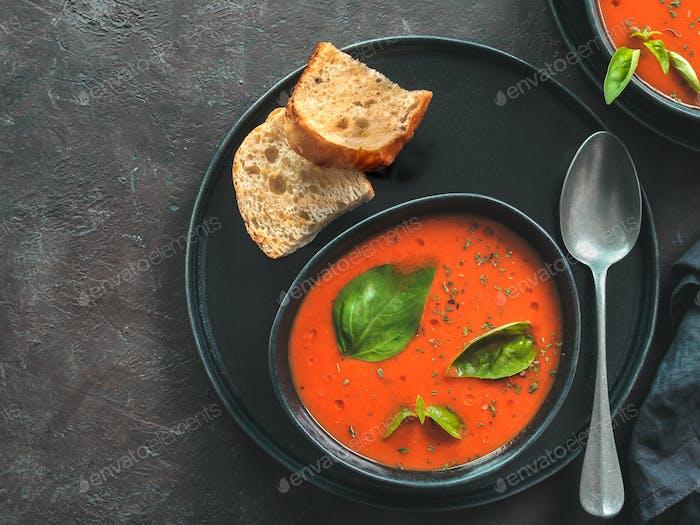 Gaspacho soup on black, top view, copy space
