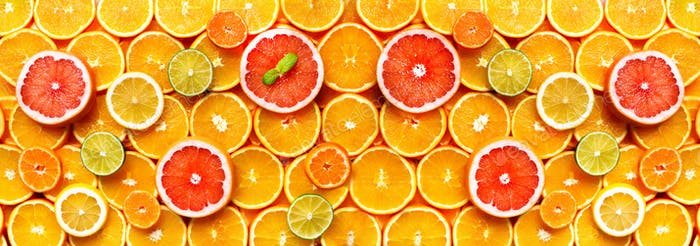 Citrus fruits background (orange, lemon, grapefruit, mandarin, lime). Food frame, vitamin concept