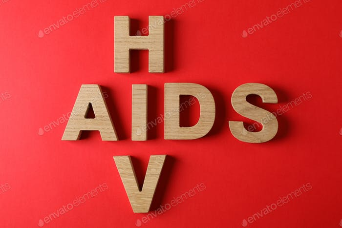 Words AIDS and HIV on red background, space for text