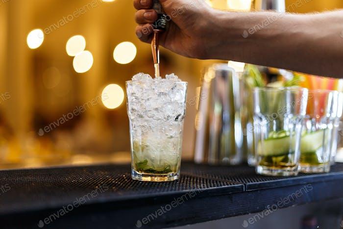 Barman making mojito