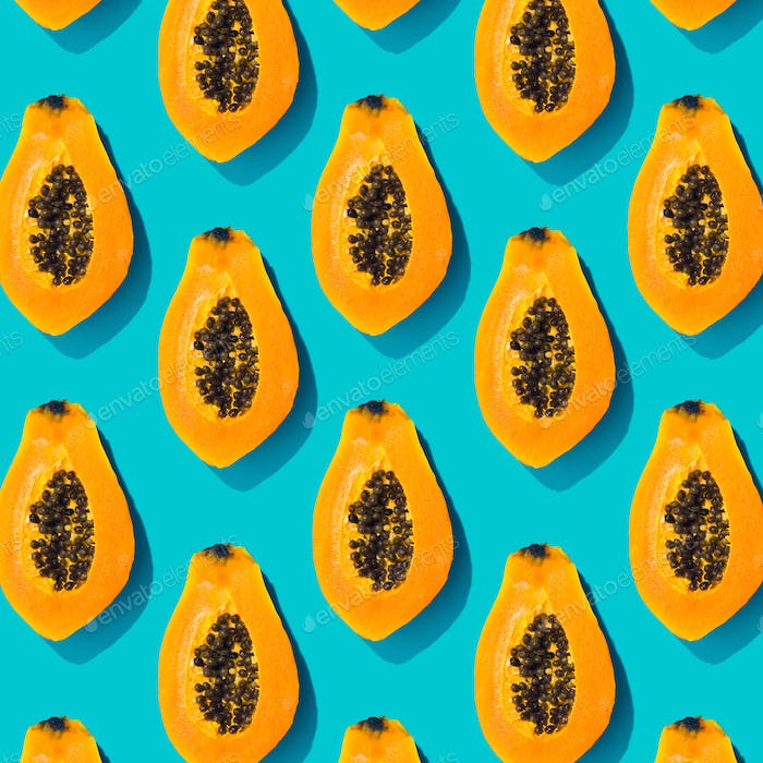 Papaya creative tropical pattern vivid blue background. Abstract summer art background.