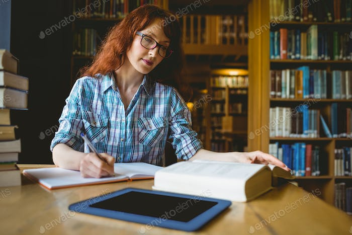 Mature student studying in library at the university
