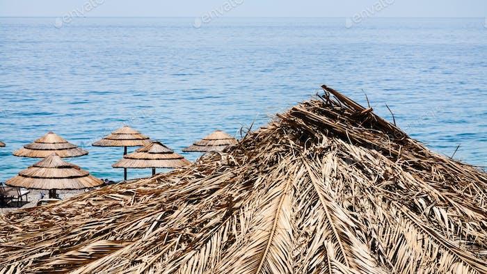 straw parasol on marina di cottone beach in Sicily