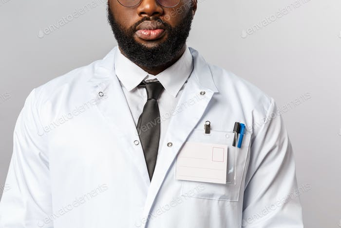 Healthcare, medicine and hospital treatment concept. Cropped shot of bearded african-american doctor