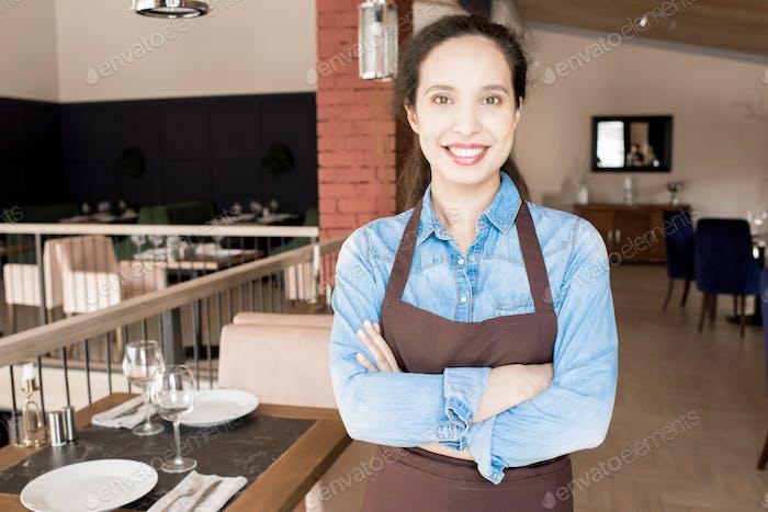 Happy confident woman of service personnel