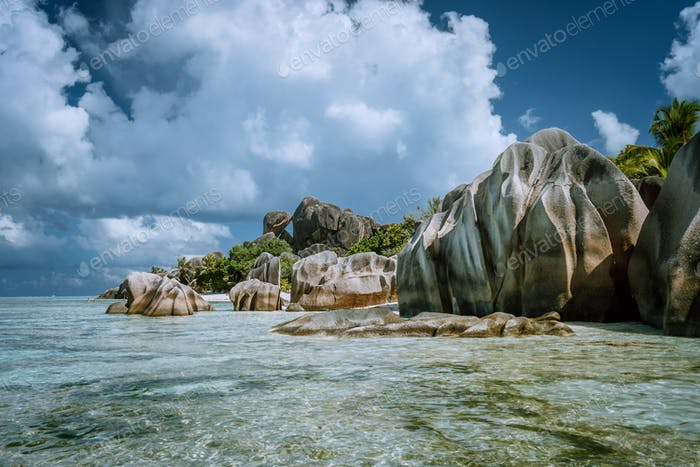Anse Source d'Argent - most famous paradise tropical beach. Bizarre granite rocks against