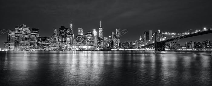 Black and white panoramic photo of Manhattan at night, NYC.