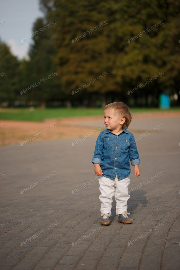 little alone boy in park