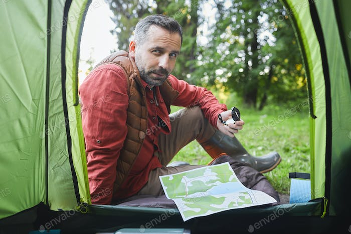 Mature Man by Camping Tent