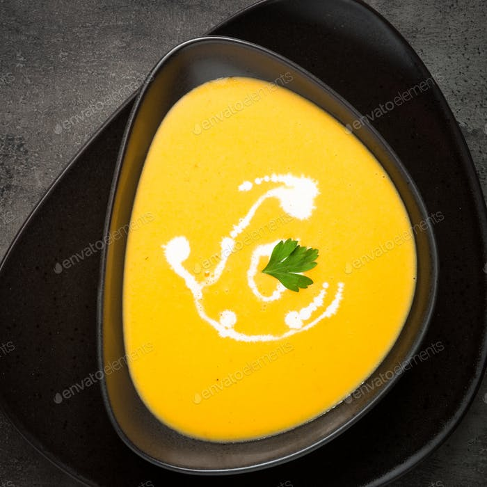 Traditional Pumpkin soup at black slate table.