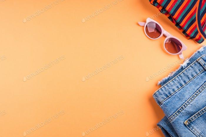Fashion flat lay frame on orange