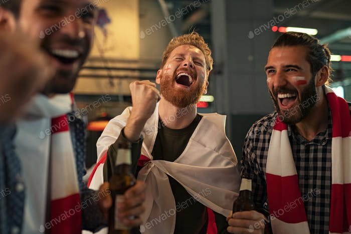 Friends celebrating victory in bar