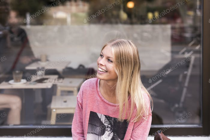 Smiling woman in front of cafe