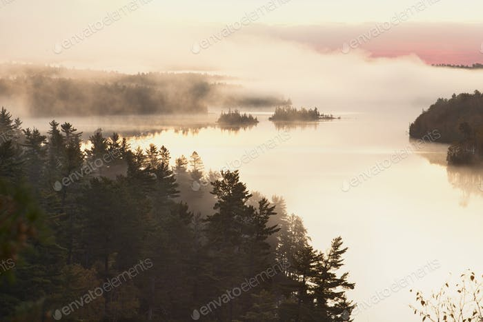 Trees and Islands in Morning Fog on Boundary Waters Lake in Minnesota