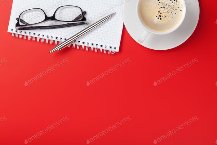 Office red workplace with coffee cup and supplies