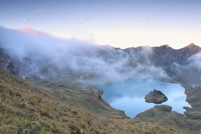 morning fog over alpine lake Schrecksee