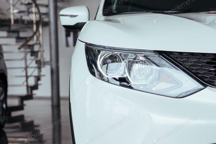 Headlights and hood of sport car