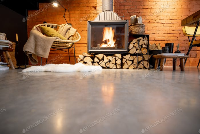 Burning fireplace with firewood at home