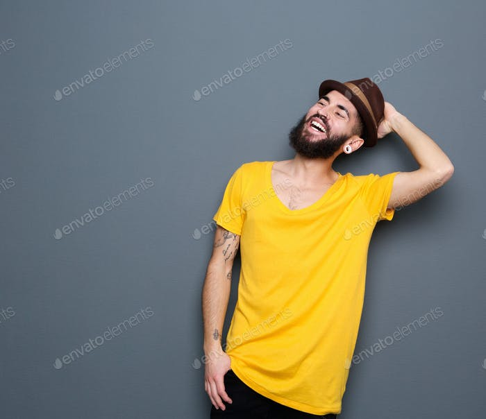 Attractive modern young man laughing