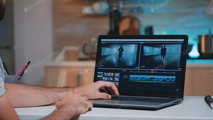 Videographer working remotely editing video footage