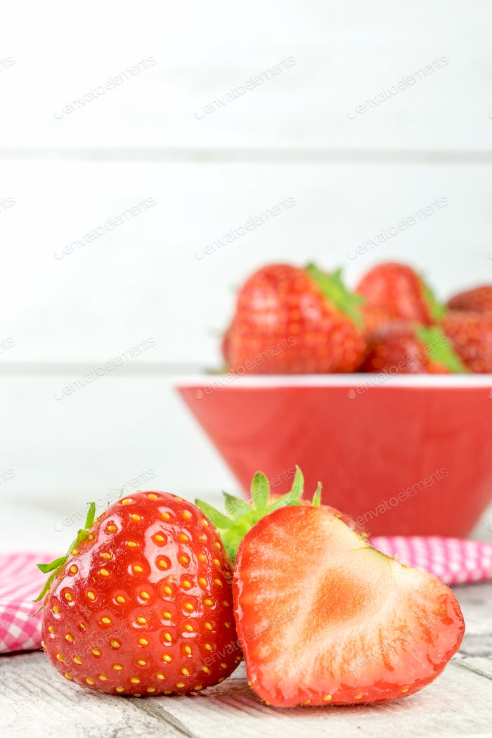 Fresh Strawberries on a Table and in a Bowl