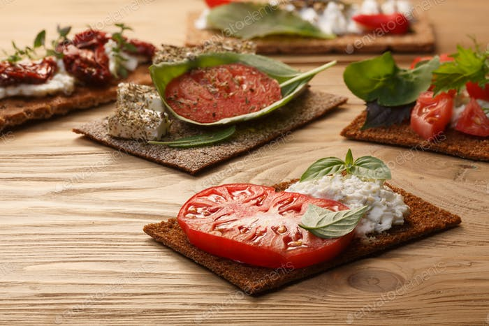 Bread crisp with tomato, cheese and basil
