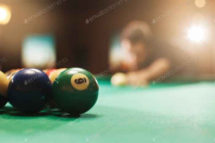 Player has prepared to hit the balls in pool.